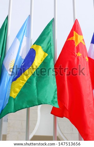 Brazil and World national flags is flying
