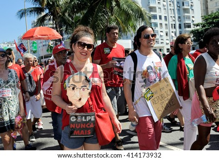 Brazil - April 17, 2016: Demonstrators make their way down Atlantica Avenue in Copacabana beach, in Rio de Janeiro, during a protest against the impeachment of President Dilma Rousseff. - stock photo