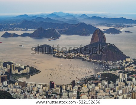 Brazil, City of Rio de Janeiro, Corcovado, Elevated view of the city with Sugarloaf Mountain and Guanabara Bay.