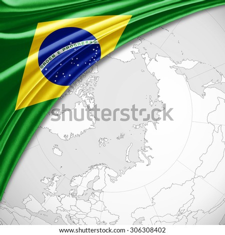 Brazil  flag of silk with copyspace for your text or images and world map background - stock photo