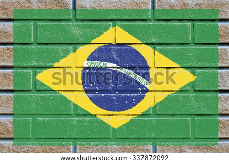 Brazil flag painted on old brick wall texture background - stock photo