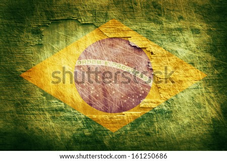 Brazil flag painted on old wooden background - stock photo