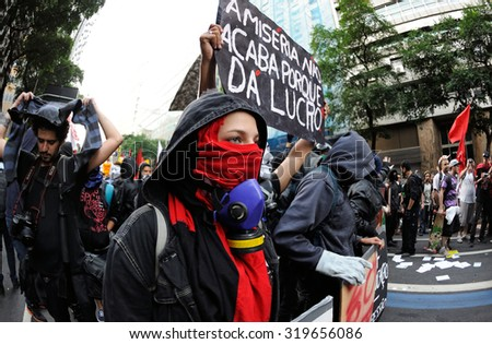 Brazil - July 11, 2013: People took to the streets of Rio de Janeiro downtown to protest against public transport fares, social exclusion, corruption and police violence. - stock photo