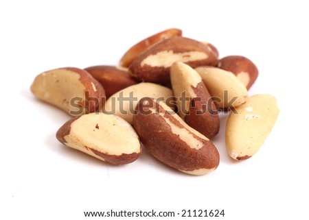 Brazil nuts (Bertholletia excelsa) isolated on white - stock photo