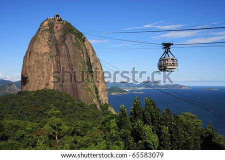 Brazil, Rio de Janeiro, Sugar Loaf Mountain - Pao de Acucar and cable car with the bay and Atlantic Ocean in the background. Rio is one of the venues for the FIFA World Cup 2014. - stock photo