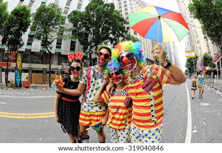 Brazil, Street block 'Cordao do Boitata' - March 2, 2014: Clowns meet Minnie Mouse at Rio Branco Avenue during carnival in Rio de Janeiro. - stock photo
