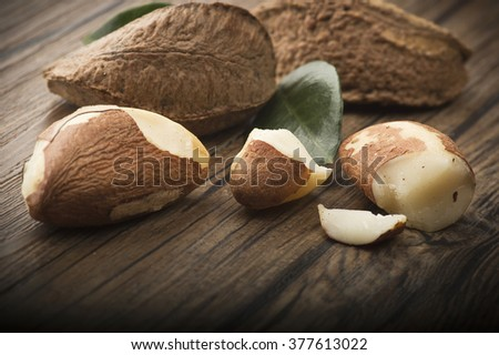 Brazil walnut close up on the wood table  - stock photo