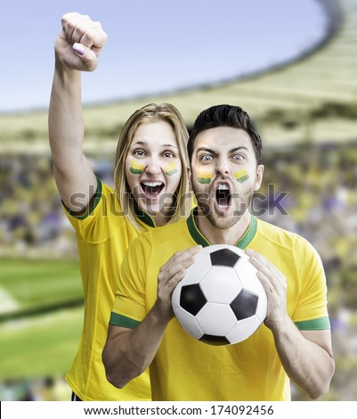 Brazilian couple celebrate on the stadium - stock photo