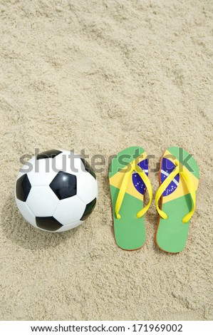 Brazilian culture can be summed up in soccer ball football and flip flops on fluffy sand of Rio beach - stock photo