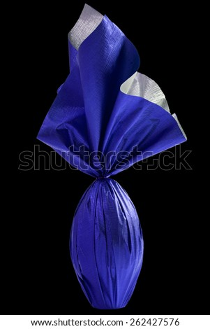 Brazilian Easters egg , wrapped in blue paper, on a black background. - stock photo