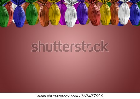 Brazilian Easters eggs hanging, on a red background. - stock photo
