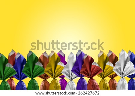 Brazilian Easters eggs, on a yellow background. - stock photo