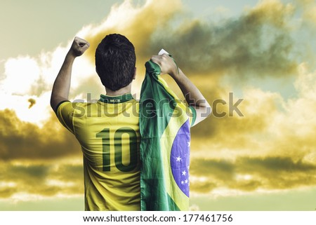 Brazilian fan celebrates on a wonderful day - stock photo