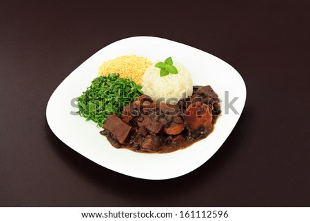 Brazilian Feijoada dish on a brown background. - stock photo