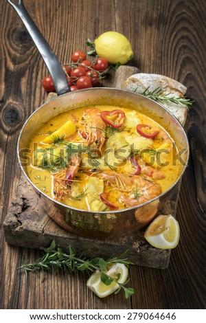 Brazilian fish and seafood stew - Moqueca de Peixe - stock photo