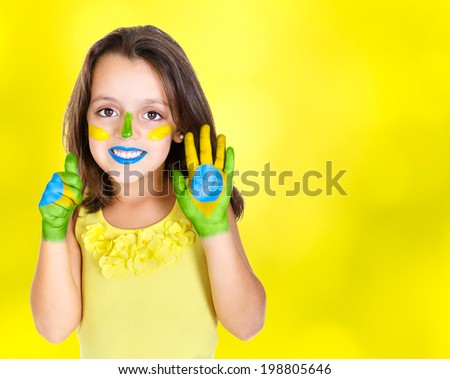 Brazilian kid fan or supporter celebrates the championship or competition or cup. - stock photo