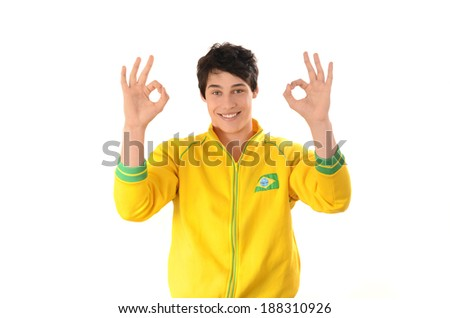 Brazilian man signing ok or zero. Attractive football fan with Brazil flag on his yellow sport blouse. Isolated on white. - stock photo