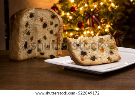 Brazilian panettone, a traditional pastry in Brazilian Christmas with a Christmas lights in the background.
