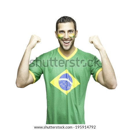 Brazilian soccer fan celebrates on white background - stock photo