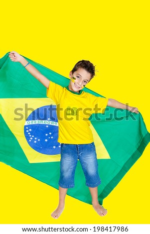 Brazilian soccer fan or supporter celebrates the championship or competition or cup. - stock photo