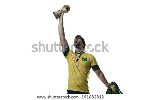 Brazilian soccer player, celebrating the championship with a trophy in his hand, on a white background. - stock photo