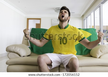 Brazilian supporter at home - stock photo