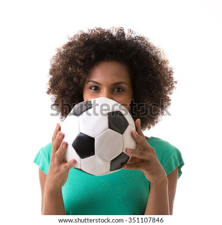 Brazilian woman playing with the soccer ball on white background - stock photo