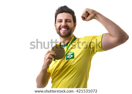 Brazilian young fan man holding a medal on white background