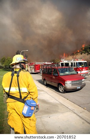 BREA, CA - NOV 15: Fire Fighters and emergency personal rush to control fires in Brea CA.  Many homes in the area have been destroyed as a result of the wildfires. - stock photo