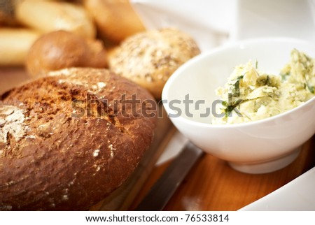 bread an roll on a wood - stock photo