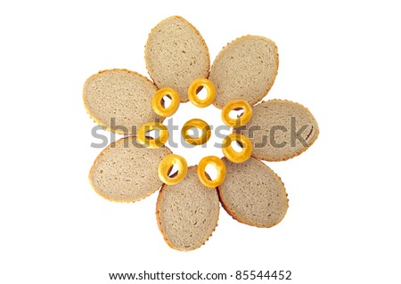 Bread and bagels laid out by a flower - stock photo