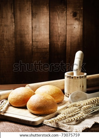 bread  and basket   on the wooden table - stock photo