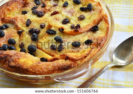 Bread and butter pudding with raisins straight from the oven - stock photo