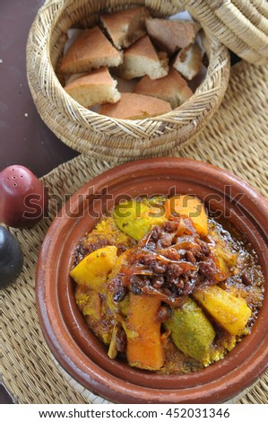 Bread and chicken couscous and vegetables with sauce of raisins and onions, in a restaurant in Marrakesh , Morocco - stock photo
