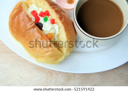 bread and coffee cup on wood texture
