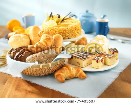Bread and dessert arrangement on table - stock photo