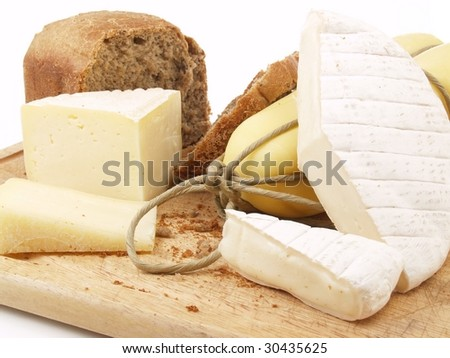bread and different cheeses on a white background - stock photo
