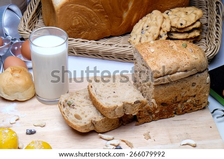 bread and rolls in wicker basket - stock photo