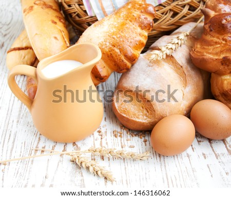 Bread and wheat corn over a old wooden background
