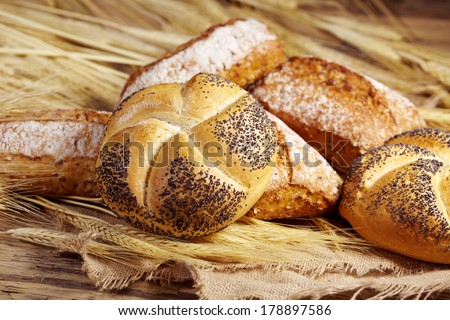 bread and wheat on the wooden  - stock photo