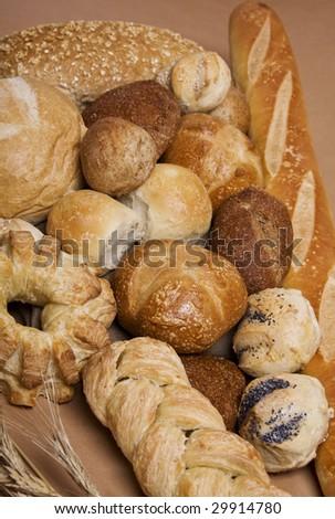 Bread assortment: baguette, whole grain, brioche, country. Focus at the center. - stock photo