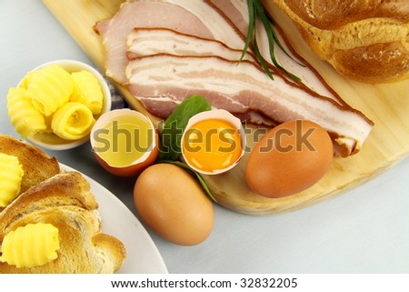 Bread, bacon, eggs with toast ready to be cooked for breakfast.