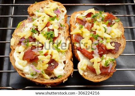 Bread baked with Mozzarella and bacon. - stock photo