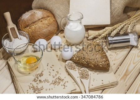 Bread.  Bread, Grain and spikelet on wooden table.  - stock photo