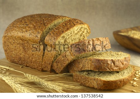 Bread cut on a blurry background (horizontal) - stock photo