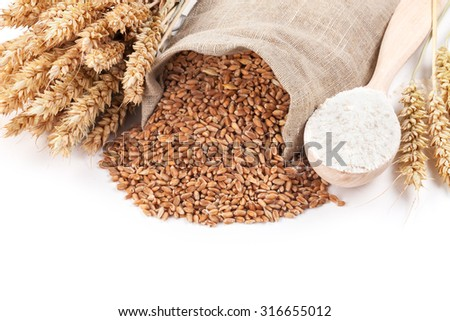 Bread, ears and grains of wheat on a white.