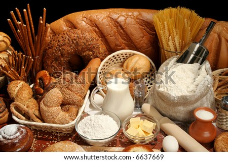 Bread, flour, milk, butter, eggs, background - stock photo