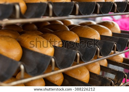 Bread freshly made. Hot loaf of bread on the baking sheet from the oven - stock photo