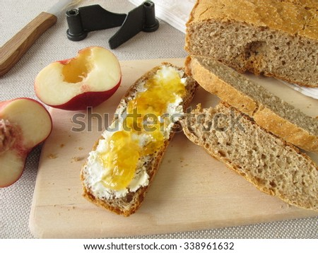 Bread from bread maker with fruit spread - stock photo