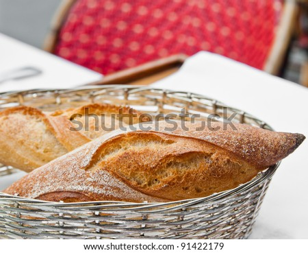 bread in basket - little roll breads in basket on table